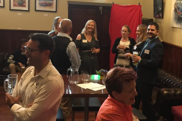 Lumos Business Solutions rebranding event with guests